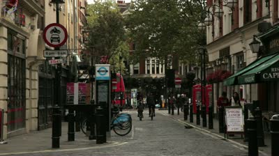 stock-footage-london-october-streets-with-unidentified-people-walking-on-the-sidewalks-in-soho-square