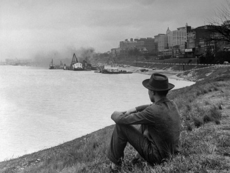 ed-clark-young-african-american-boy-sitting-on-memphis-riverbank-watching-boats-on-the-mississippi-river